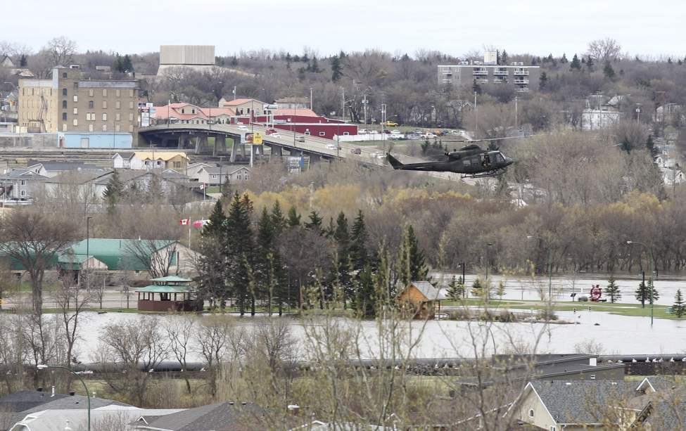 A military helicopter makes a pass over Kirkcaldt Drive as it comes in for a landing near 18th Street on Wednesday in Brandon, Manitoba.  May 11, 2011 (Bruce Bumstead/Brandon Sun)