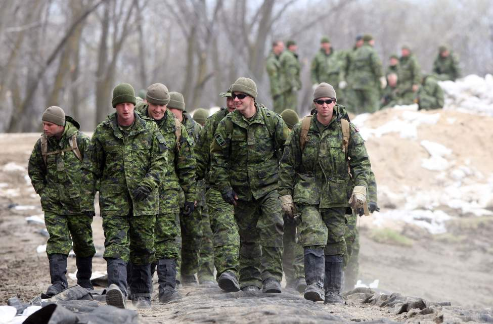 Members of 2 PPCLI  Shilo reinforce a dike on the Assinboine River off Hyw 430, north of  Oakville, MB Thursday- Soldier walk on dike.  May 12, 2011. (Joe Bryksa / Winnipeg Free Press)