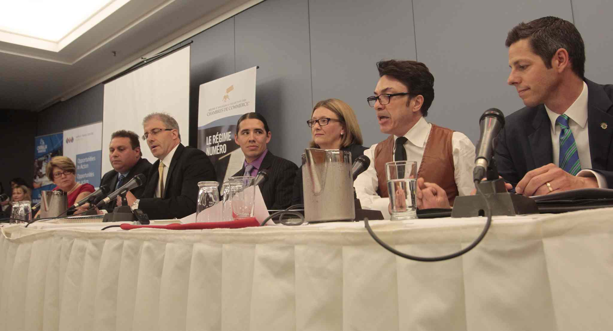 From right, mayoral candidates Brian Bowman, Michel Fillion, Paula Havixbeck, Robert-Falcon Ouellette, Gord Steeves, Michael Vogiatzakis and Judy Wasylycia-Leis at the luncheon Wednesday.