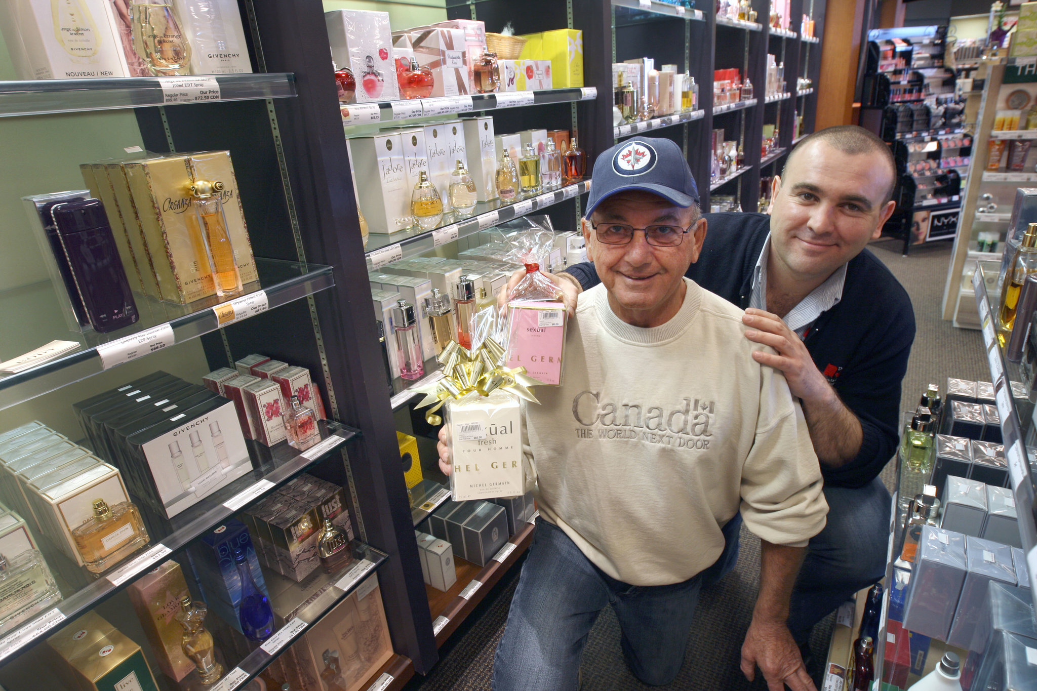 Michael Resch, left, with his son Simon, the manager of the Emerson Duty Free Shop selling gift items, alcohol and smokes. The elder Resch is being recognized by the Canadian Tourism Hall of Fame.