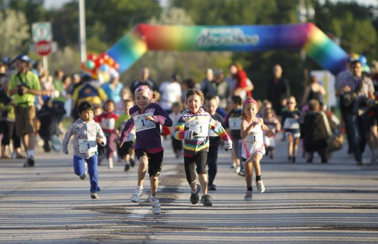 Young runners sprint in the mini-mites race before the Manitoba Marathon Sunday morning.