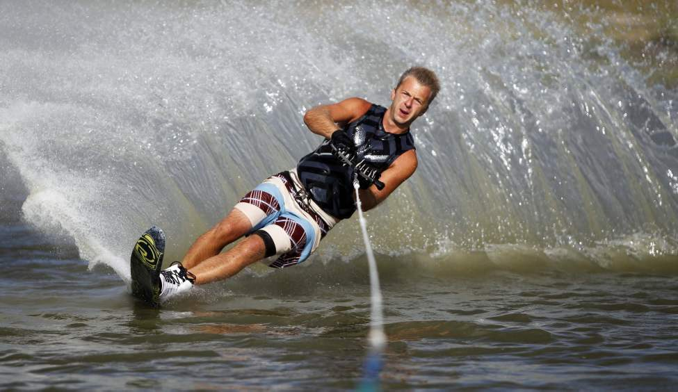 Craig Dueck practices some of his waterski cuts at the pond on Murdock Road. Dueck comes several times a week with his buddies to sharpen up his skills on the water. 