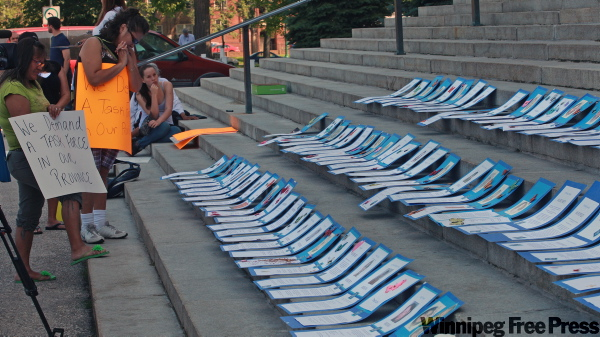 Pictures of 70 missing and slain women were laid on the steps of the Manitoba Legislative Building during a protest  in 2009 calling for a task force to investigate the cases.