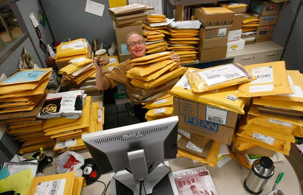 Free Press Arts Columnist and Book Editor Morley Walker returned to work on Wednesday to be greeted by a  mountain of mail. Walker was among workers returning after a 16-day strike of unionized employees ended Tuesday night. Your Free Press will be back on your doorstep and on the street Thursday.