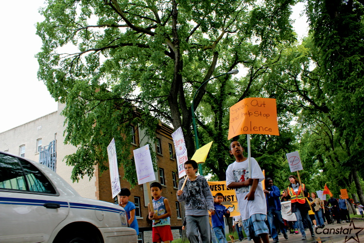 More than 100 West End residents took to the streets June 22 to march against violence.