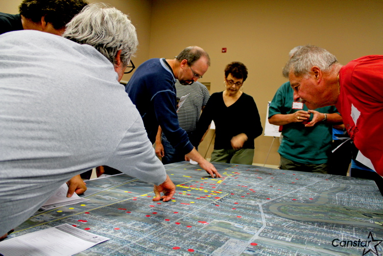 Charleswood residents and landowners mark their property on a map at a June 20 open house on the development of Ridgewood South.