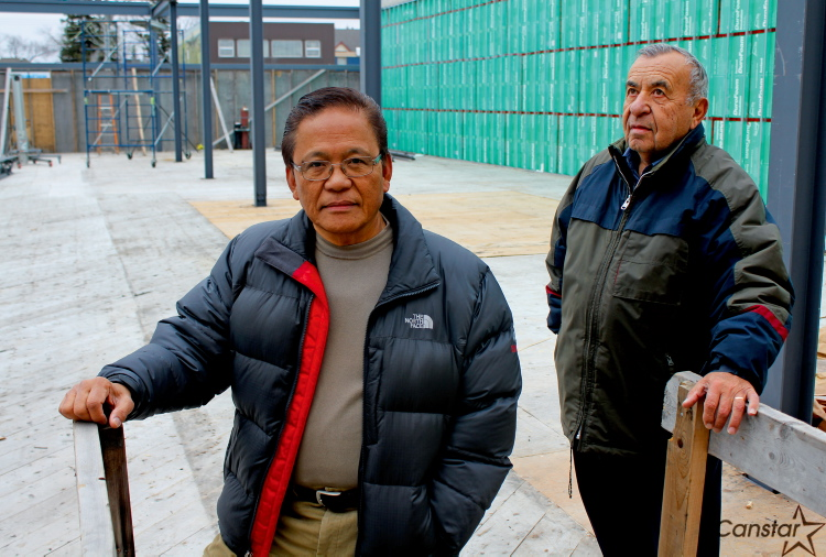 Rudy Torres (left) and John Georgopoulos are redeveloping the site at 1851 Portage Ave., which was destroyed in an arson in 2009.
