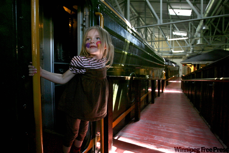 Isabella Monchamp, 3, climbs aboard the train at the Children's Museum in July during a family visit. The Children's Museum was named Best of the Road in Rand McNally's 2010 Road Atlas.
