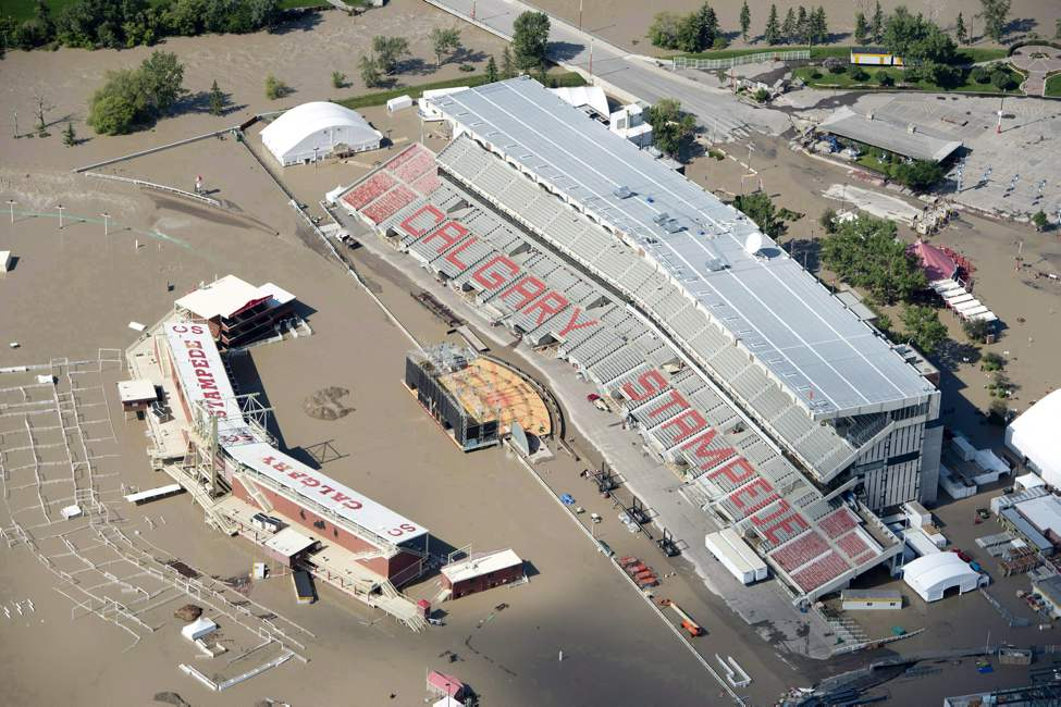 A flooded Calgary Stampede stadium is seen from a aerial view in Calgary Saturday, June 22, 2013. Environment Canada says floods were big newsmakers in Canada in 2013, and June's record flooding in Calgary and southern Alberta leads its Top 10 weather stories of the year. THE CANADIAN PRESS/Jonathan Hayward (CP)
