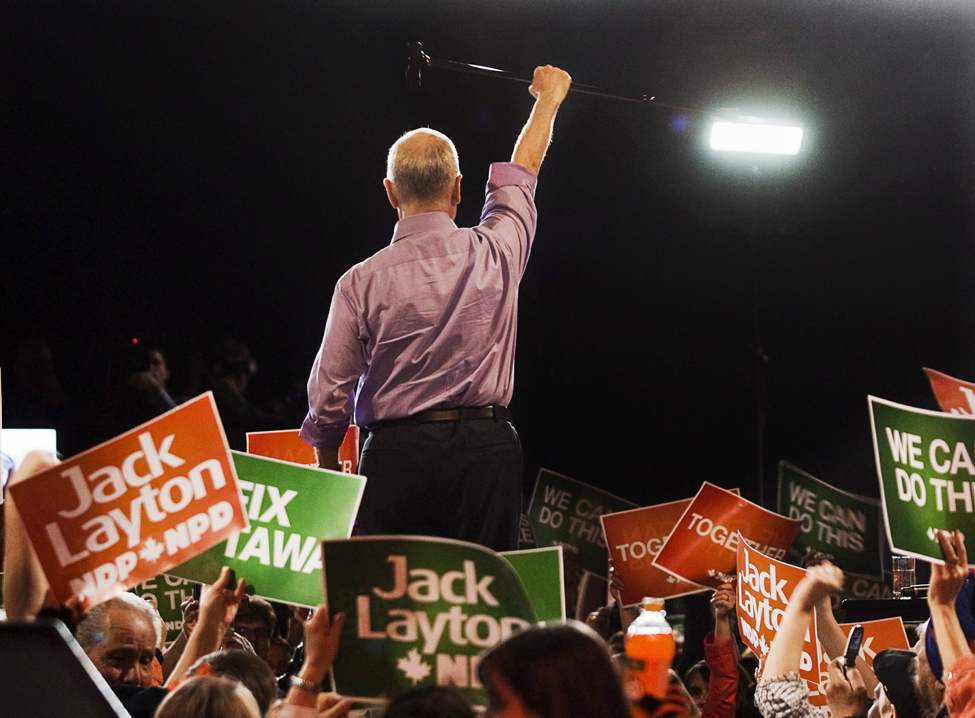 NDP Leader Jack Layton raises his cane to the crowd at a campaign rally in Burnaby, B.C. on Friday, April 30, 2011.  THE CANADIAN PRESS/Andrew Vaughan