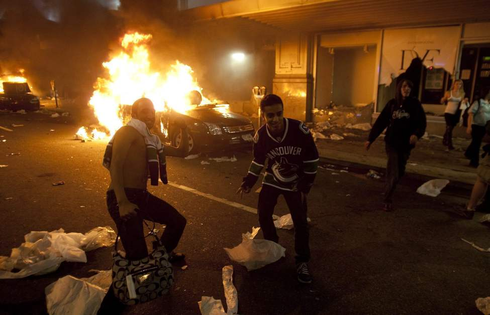 Vancouver Canucks hockey fans take part in a riot in downtown Vancouver, Wednesday, June 15, 2011 following the Vancouver Canucks 4-0 loss to the Boston Bruins in game 7 of the Stanley Cup hockey final.   THE CANADIAN PRESS/Ryan Remiorz