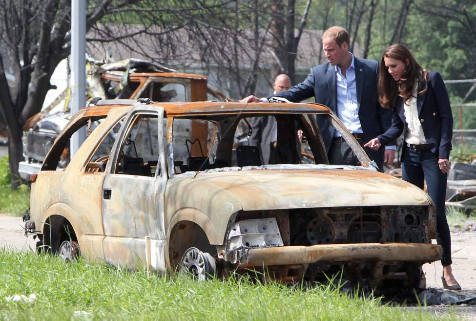 The Duke and Duchess of Cambridge look at a burned-out car in Slave Lake, Alta., on Wednesday, July 6, 2011. The couple will meet rescue workers and families who lost everything in May's devastating wildfire.  THE CANADIAN PRESS/Jonathan Hayward