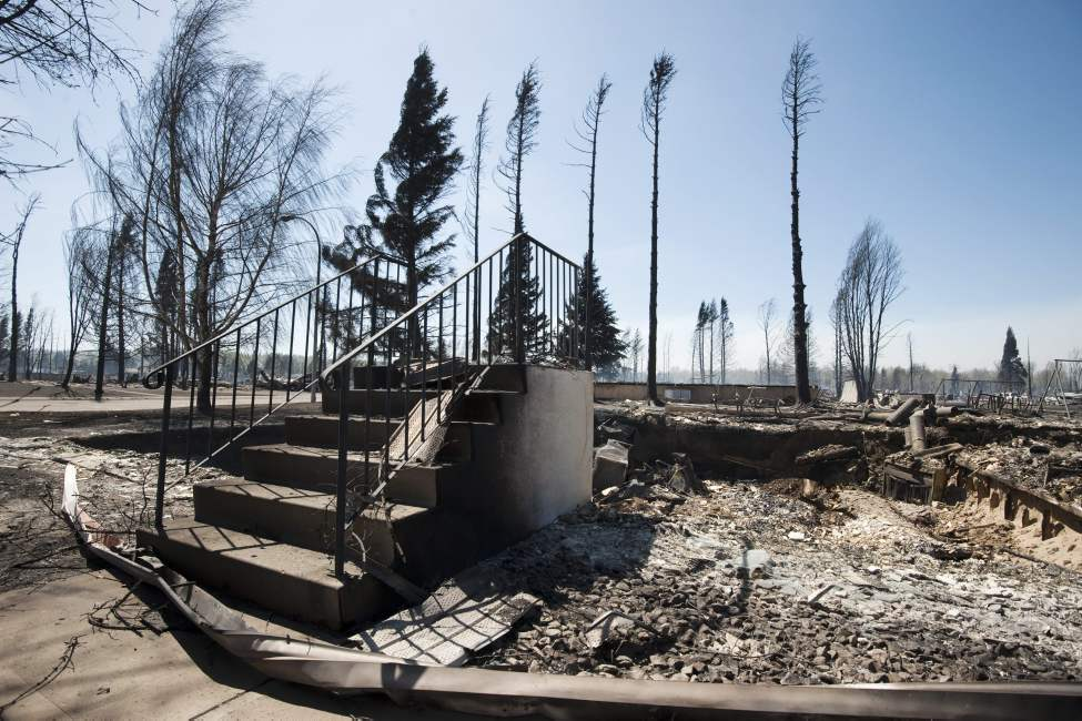 All that remains of a house in Slave Lake, Alberta, on Monday, May 16, 2011 is a set of steps. Whole neighbourhoods were flattened by a devastating wildfirethat swept through the town of 7,000 destroying upwards of 40% of the buildings. THE CANADIAN PRESS/Ian Jackson