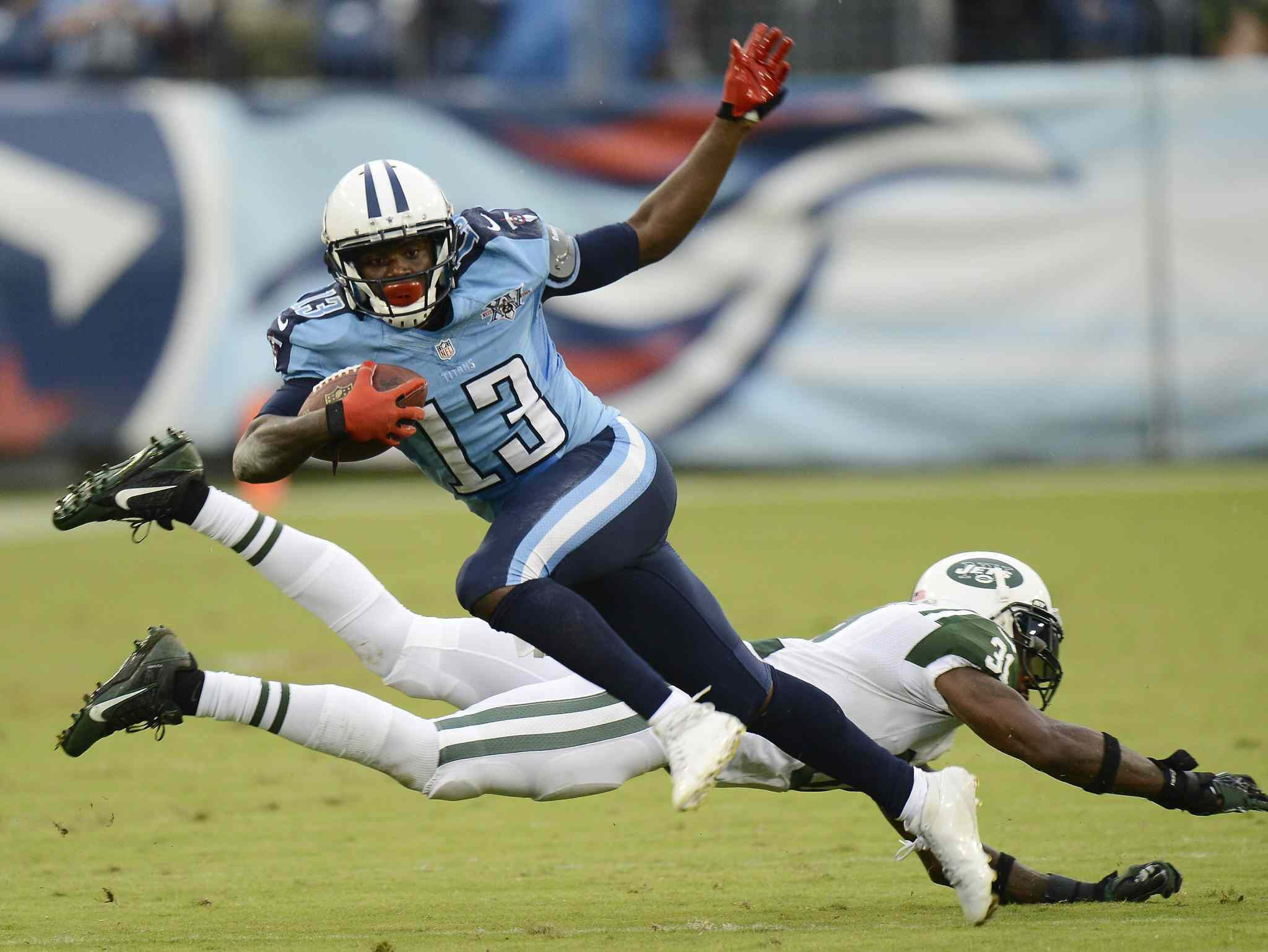 Tennessee Titans wide receiver Kendall Wright gets past New York Jets cornerback Antonio Cromartie during the Titans 38-13 victory, Sunday in Nashville.