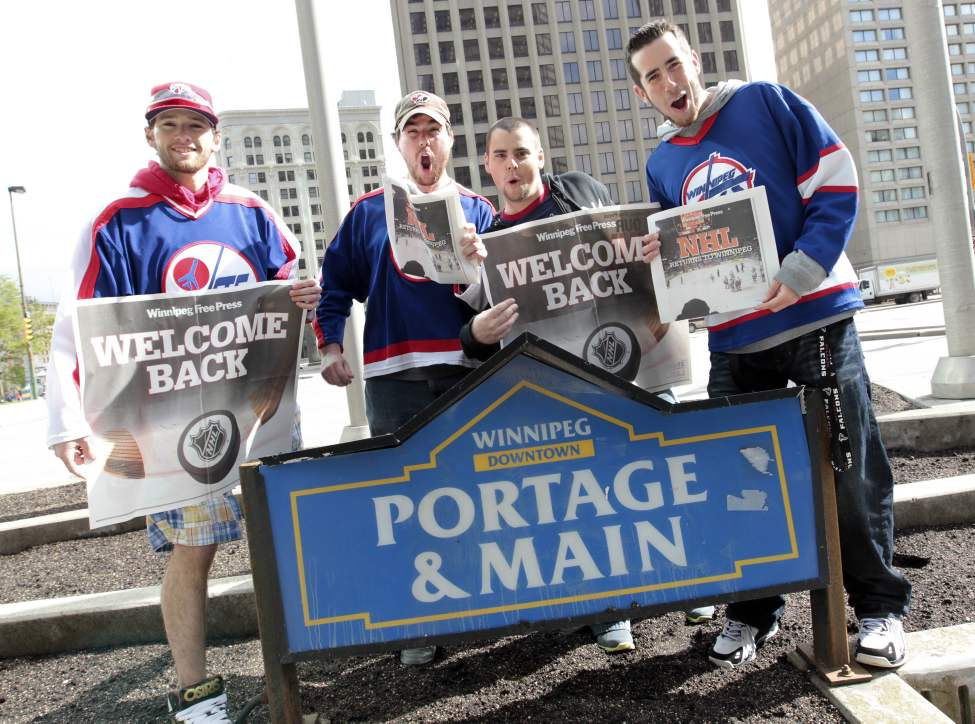 Hockey fans gathered at Portage and Main to celebrate the return of the NHL to Winnipeg, MB. (l-r) Mark Patton, Dana Judd, Damien Lemoine and Miguel Marcoux arrived early at Portage and Main for the party. (MIKE DEAL / WINNIPEG FREE PRESS)
