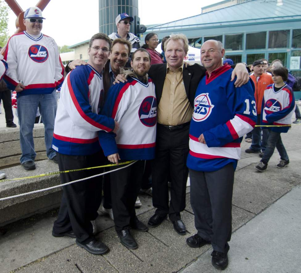 Winnipeg hockey supporters pose with former Winnipeg Jet  and currect city councillor Thomas Steen at The Forks in Winnipeg, Tuesday May 31, 2011  after the announcement that an NHL team will be returning to the city after 15 years.  (DAVID LIPNOWSKI / THE CANADIAN PRESS)
