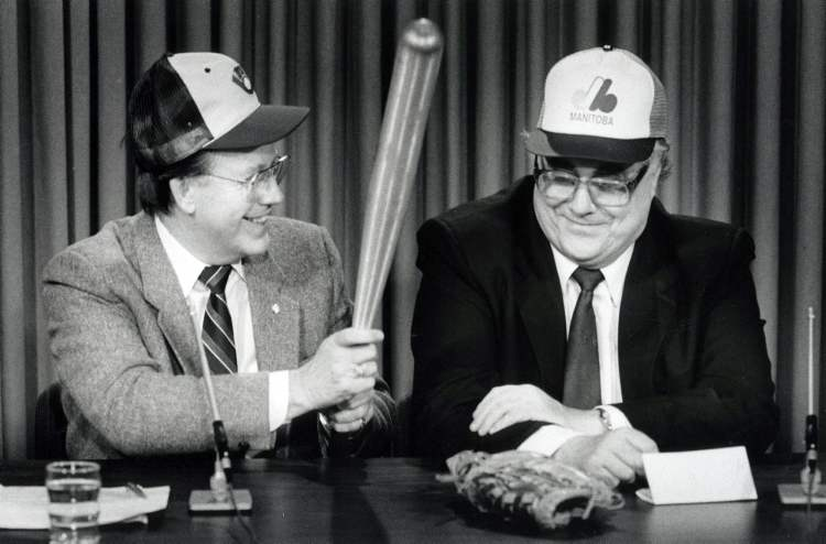 Mayor Bill Norrie jokes with Manitoba Sports Minister Larry Desjardins during a press conference announcing a $6-million agreement between the province and the city to build a baseball stadium, 1986  (WAYNE GLOWACKI / WINNIPEG FREE PRESS archives)