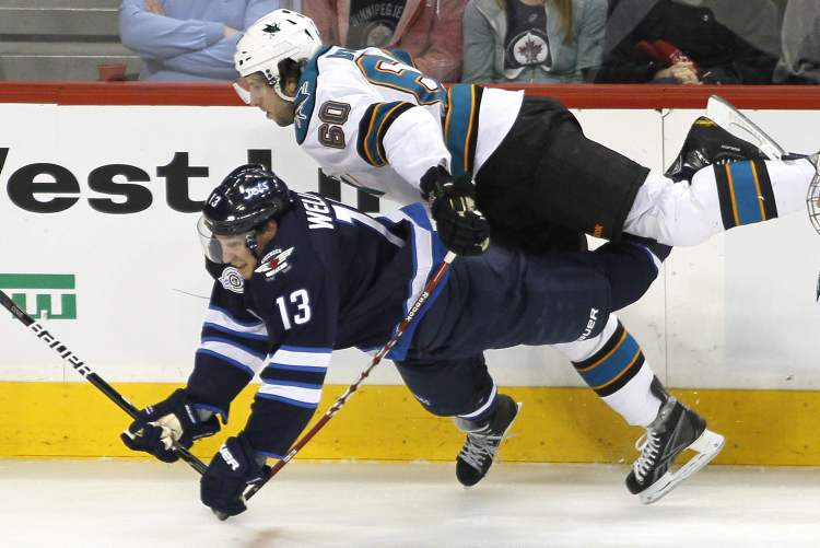 Is Winnipeg Jets' Kyle Wellwood (13) suffering a streak of bad luck? Has he scored this year? Do we really need to say anything else? THE CANADIAN PRESS / John Woods (CP)