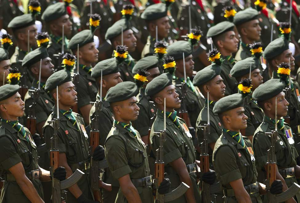Sri Lankan army soldiers stand during a ceremony to mark the 63rd anniversary of the army in Colombo, Sri Lanka, Wednesday, Oct. 10, 2012. (AP Photo/Gemunu Amarasinghe)