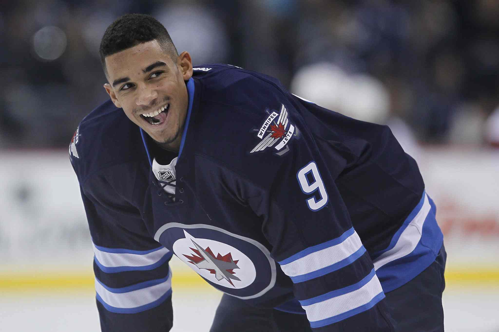 Winnipeg Jets' Evander Kane smiles at the crowd during the pre-game.