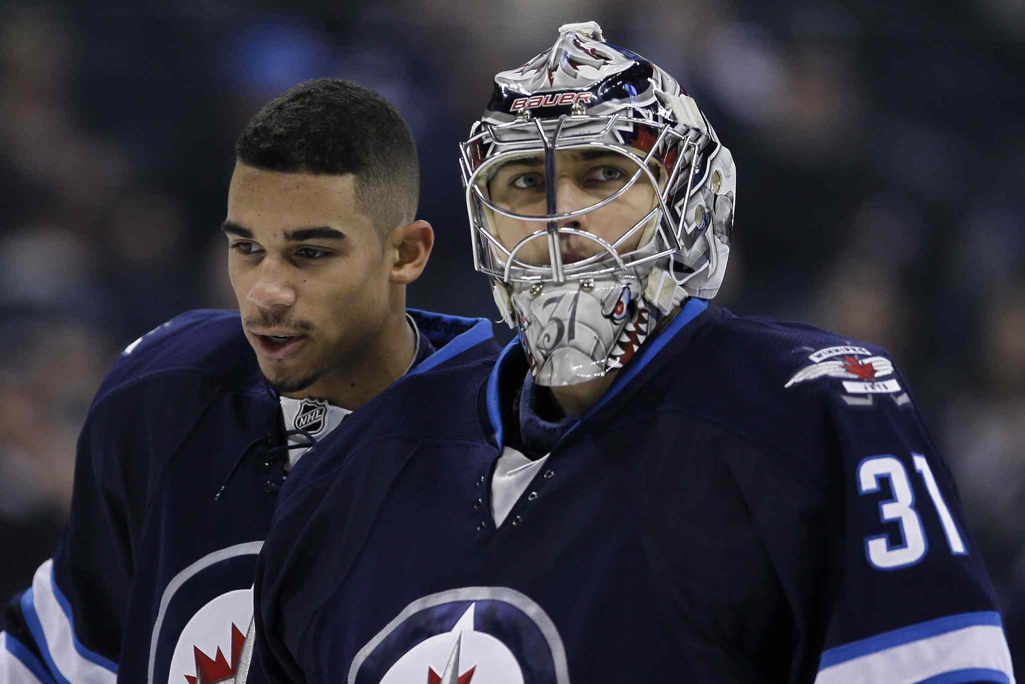 Goaltender Ondrej Pavelec and Evander Kane during the pre-game.