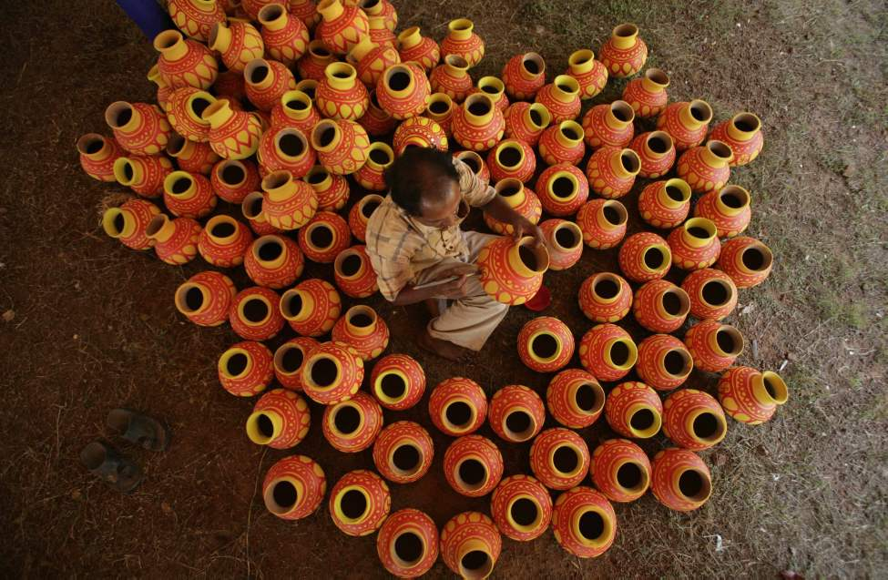 An Indian artist paints earthen pots which will be used by Hindu women during the Navratri festival in Bhubaneswar, India, Monday, Oct. 15, 2012. Navratri, or the festival of nine nights, begins Tuesday. (AP Photo/Biswaranjan Rout)