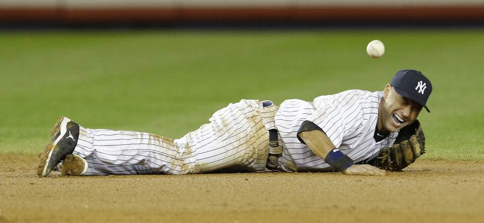 New York Yankees shortstop Derek Jeter reacts after injuring himself in the 12th inning of Game 1 of the American League championship series against the Detroit Tigers early Sunday, Oct. 14, 2012, in New York.(AP Photo/Paul Sancya )