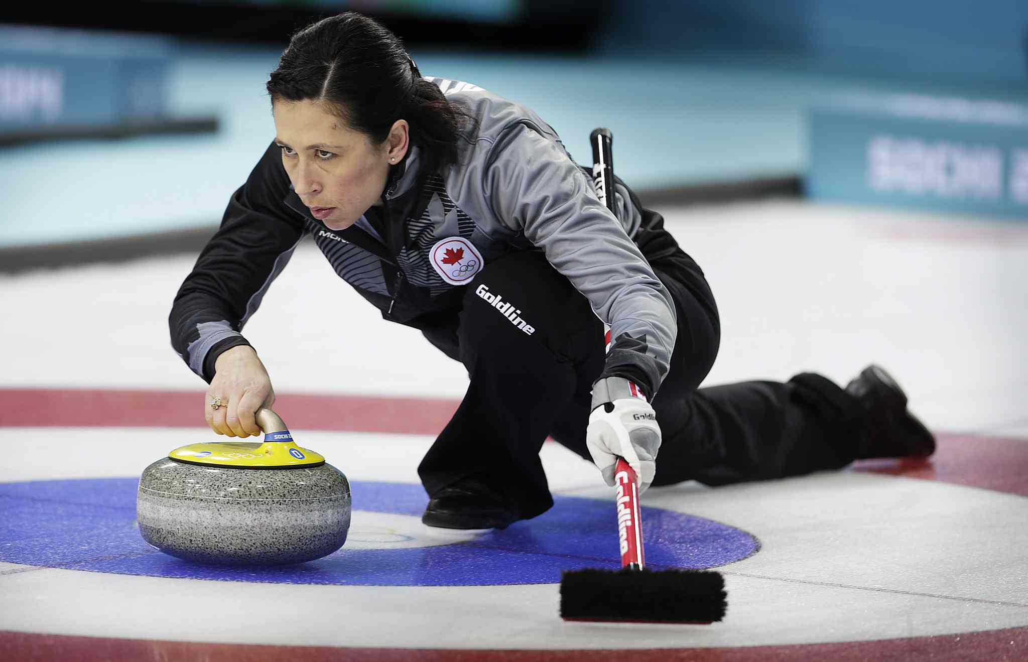 Jill Officer delivers a rock during a training session at the 2014 Winter Olympics.