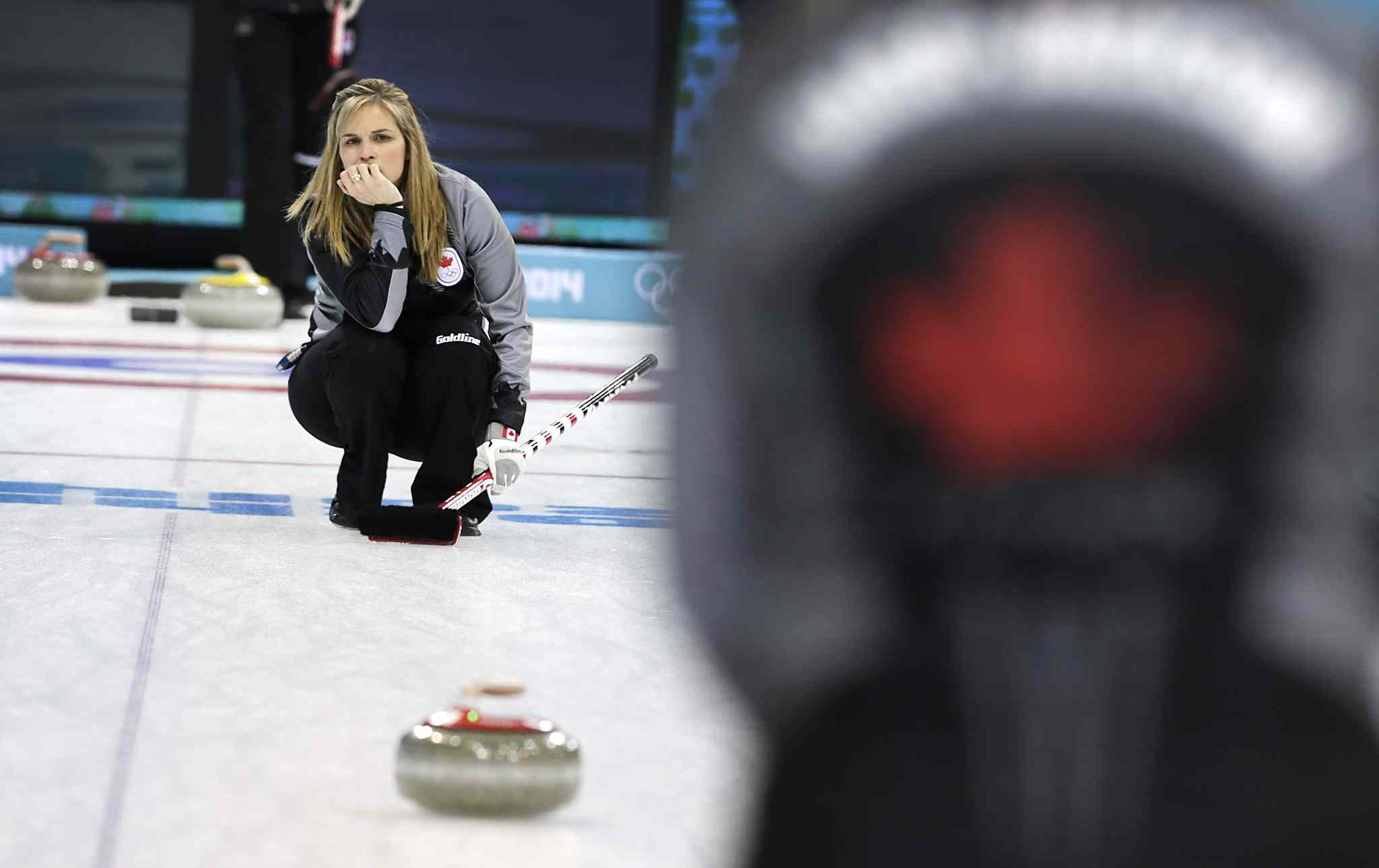 Jennifer Jones watches a rock during a training session at the 2014 Winter Olympics.