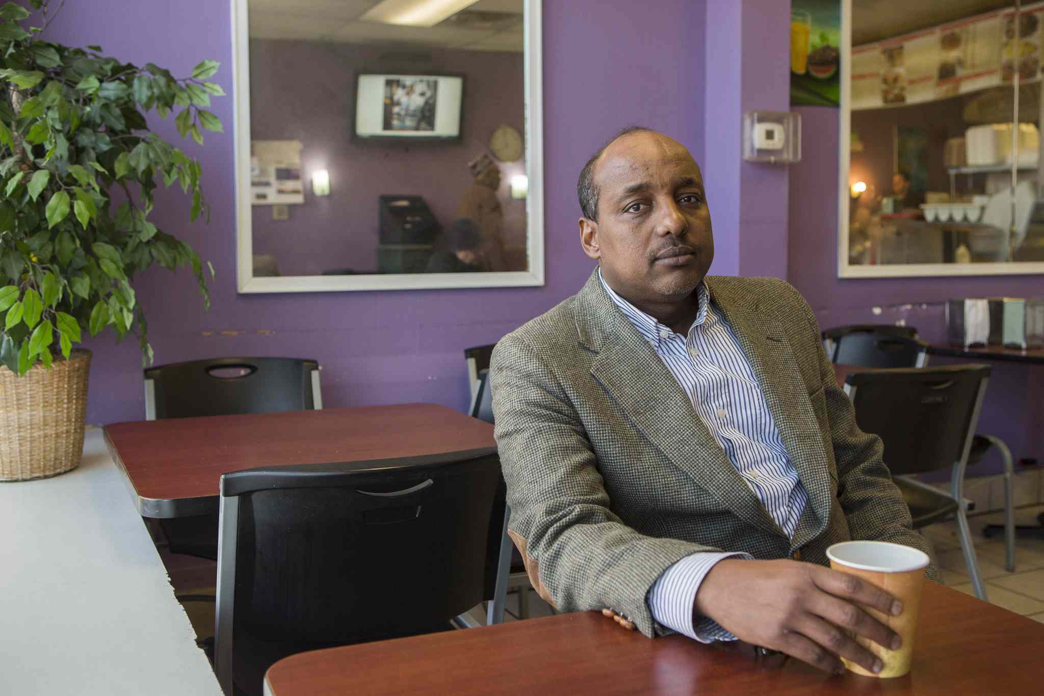 """""""The word on the street right now is not to leave the country, because maybe you'll not be able to come back. You simply don't know what this administration will do. You're playing a different ball game,"""" says Somali community activist Omar Jamal."""