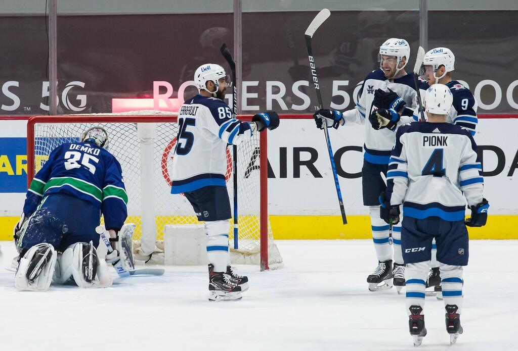 Mathieu Perreault, Pierre-Luc Dubois, Andrew Copp and Neal Pionk celebrate Copp's second goal against Vancouver on Wednesday. (Darryl Dyck / The Canadian Press)
