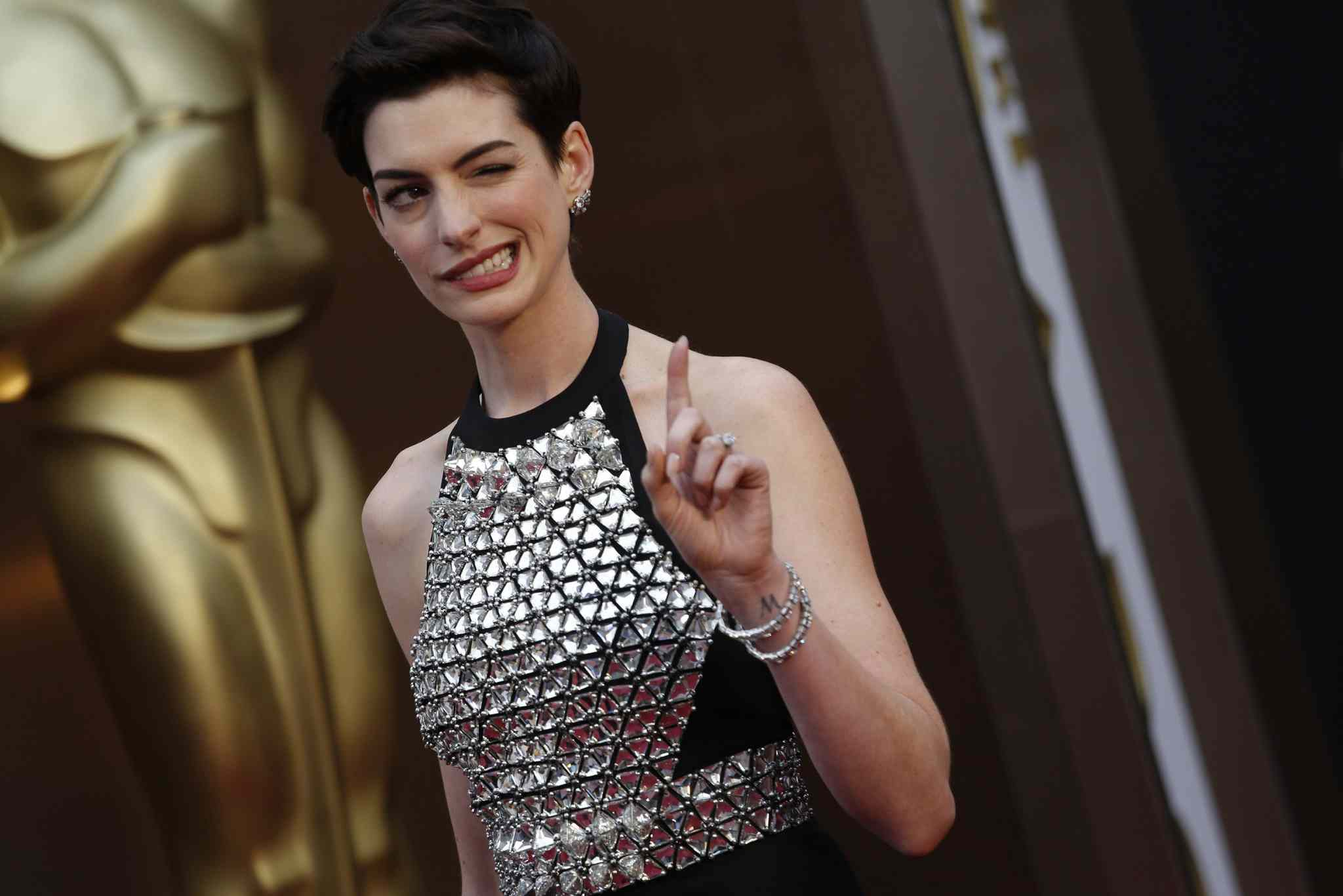 Anne Hathaway arrives at the 86th annual Academy Awards at the Dolby Theatre at Hollywood & Highland Center in Los Angeles.