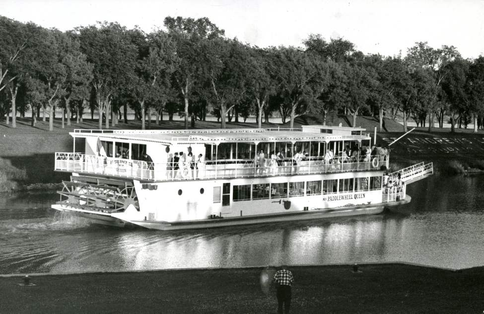 From the August 1st edition of the Winnipeg Free Press: Replica of a 19th century stern-wheeler strated regular cruises on the Red River Wednesday. The boat leaves its home dock near Nairn Avenue, in Elmwood, makes a trip to a point just past Middlechurch and returns in three hours. Tentative schedule calls for three trips on weekdays, four trips Saturdays and Sundays. There is a band on board for the last trip each day, at 10 p.m.; recorded music (via stereo) on other trips. Paddlewheel Queen - July 30, 1965
