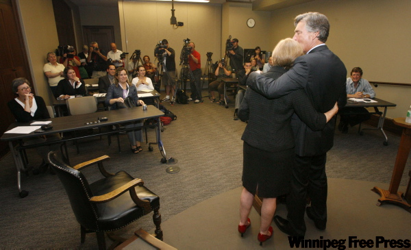 Manitoba Premier Gary Doer embraces his wife Ginny Devine as he announces his resignation at a press conference at the Manitoba Legislature. Doer did not announce the exact date he will be stepping down, though he indicated that it would likely be at the beginning of October.