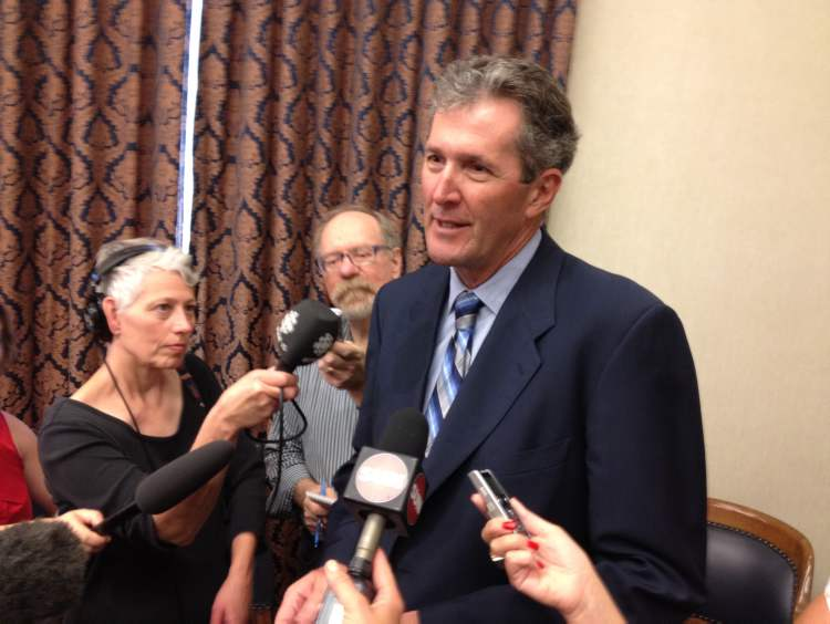 Brian Pallister, the newly acclaimed leader of Manitoba's Progressive Conservative party, speaks to reporters Monday.
