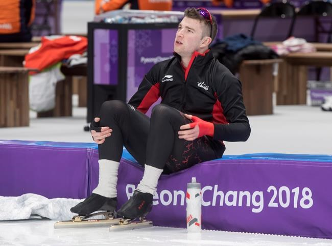 Speed skater Alexandre St-Jean takes a break during a practice Monday, February 5, 2018 in Gangneung, South Korea. THE CANADIAN PRESS/Paul Chiasson