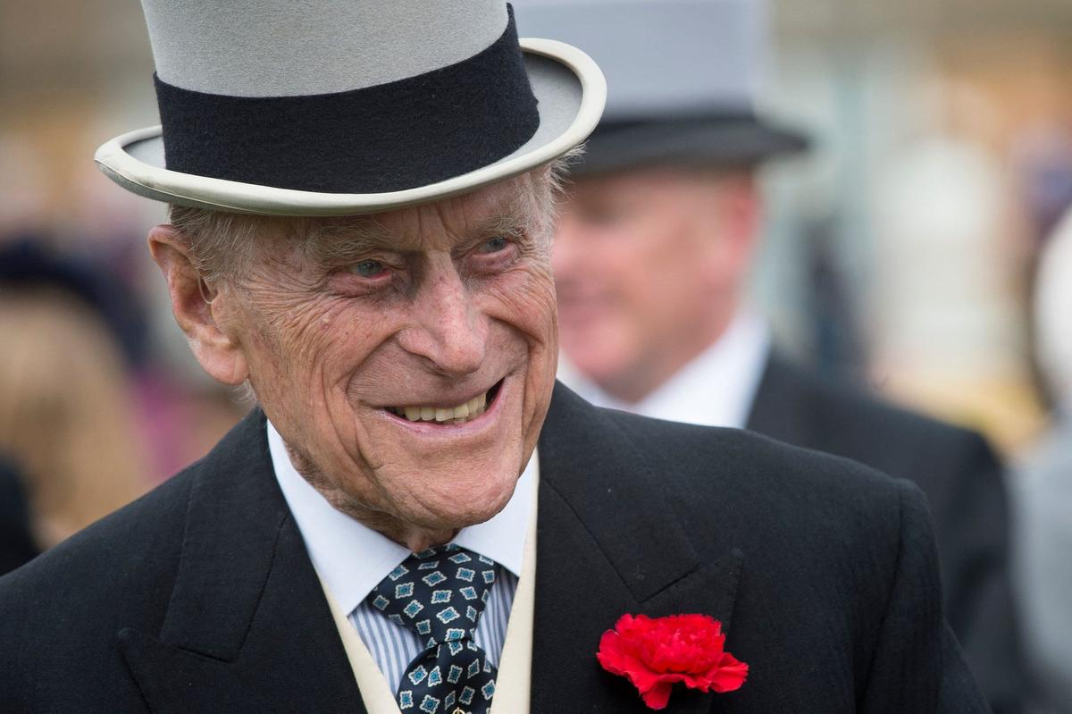 Prince Philip, Duke of Edinburgh greets guests at a garden party at Buckingham Palace in London on May 16, 2017.