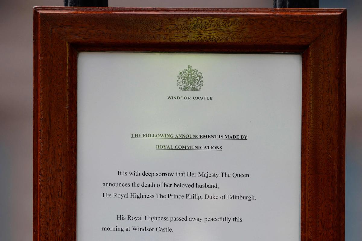 An official notice announcing the death of Britain's Prince Philip, Duke of Edinburgh is seen on the gates of Buckingham Palace in central London on April 9.