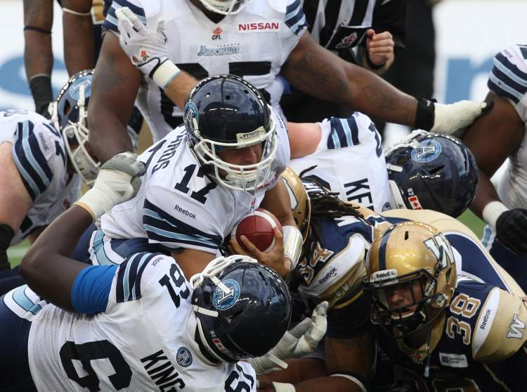 Toronto Argonauts back-up quarterback Zach Collaros (#17) gets across the goal line for a touchdown during the second quarter.