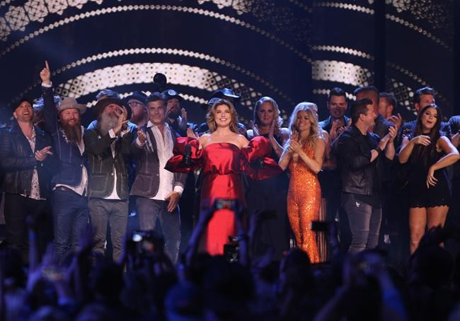 Shania Twain is joined on stage by all of the performers at the end of the Canadian Country Music Awards in Hamilton, Ont. on Sunday, September 9, 2018. THE CANADIAN PRESS/Peter Power