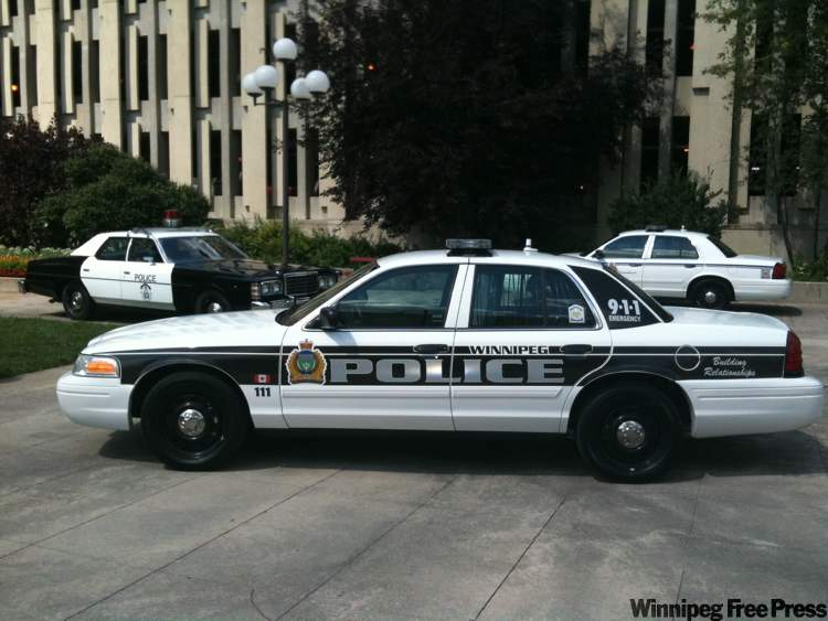New police cruiser sports a black-and-silver reflective design for better visibility.