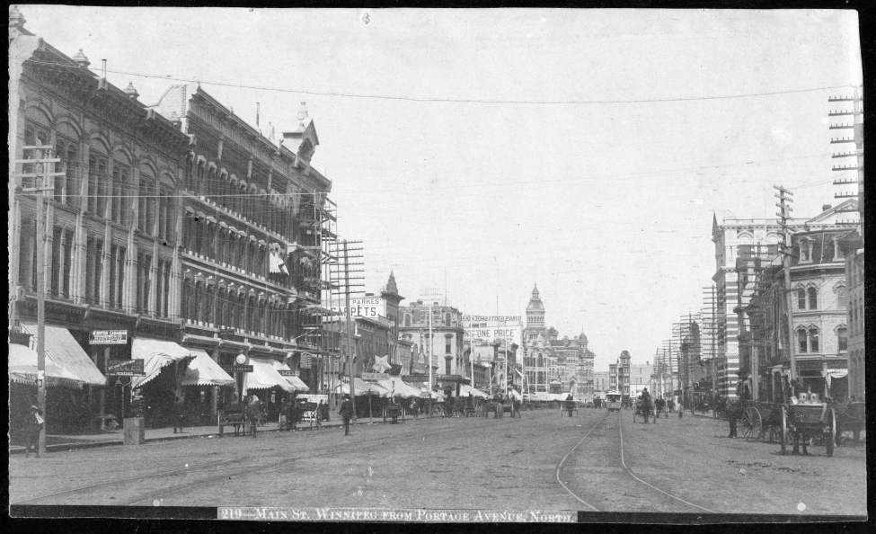 Looking north on Main Street from Portage Avenue, undated. The old city hall building can be seen in the distance. (Winnipeg Free Press Archives)
