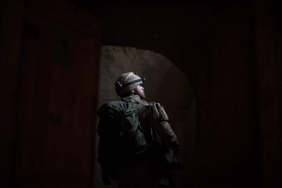 Canadian Army soldier Cpl. Mathieu Caron, 23, of Quebec, Canada, with the1st Battalion Royal 22nd Regiment searches a room inside a compound during one of their final operations Wednesday, June 29, 2011 in the Panjwaii district of Kandahar province, Afghanistan. (AP Photo/David Goldman)