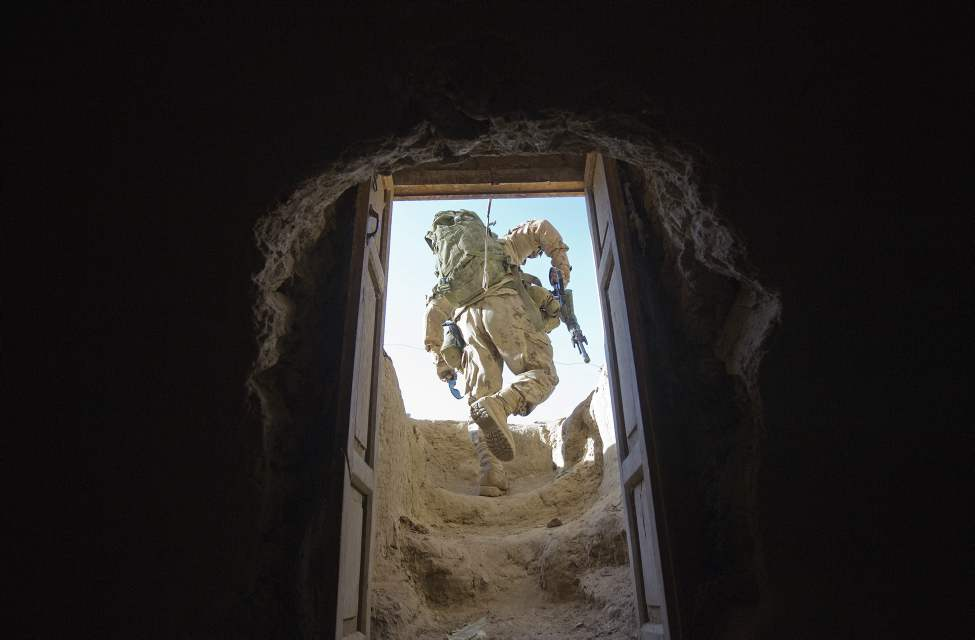 Canadian Army soldier Cpl. Mathieu Caron, 23, of Quebec, Canada, with the1st Battalion Royal 22nd Regiment exits a room after searching a compound during one of their final operations Wednesday, June 29, 2011 in the Panjwaii district of Kandahar province, Afghanistan. (AP Photo/David Goldman)