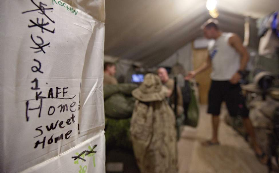 A tent for soldiers of the Canadian Army's 1st Battalion Royal 22nd Regiment is decorated with a countdown until their return home Wednesday, June 29, 2011 at Forward Operating Base Sperwan Ghar in the Panjwaii district of Kandahar province, Afghanistan. (AP Photo/David Goldman)