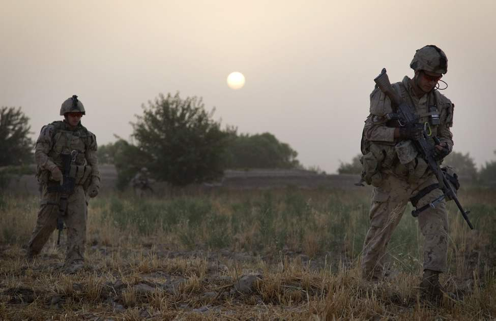 Soldiers with the Canadian Army's 1st Battalion 22nd Royal Regiment, patrol at sunrise Sunday, June 26, 2011 in the Panjwaii district of Kandahar province, Afghanistan. (AP Photo/David Goldman)
