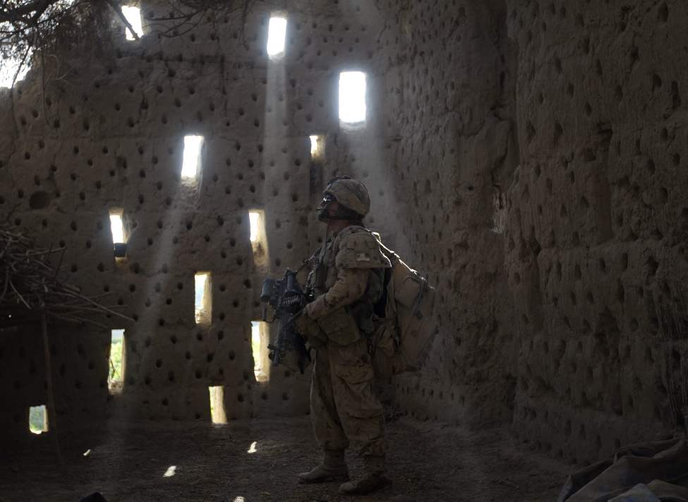 Pvt. Maxeme Jauvin, 22, of Quebec Canada, with the Canadian Army's 1st Battalion Royal 22nd Regiment searches a compound on their final operation Thursday, June 30, 2011 in the Panjwaii district of Kandahar province, Afghanistan. (AP Photo/David Goldman)