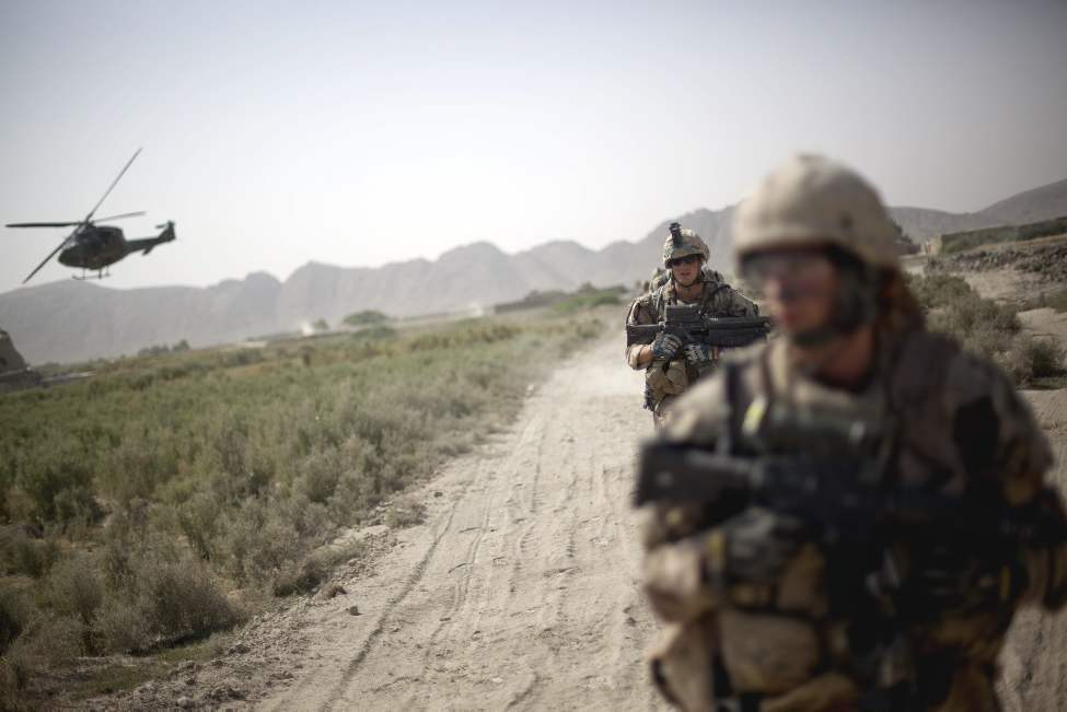 Soldiers with the Canadian Army's 1st Battalion Royal 22nd Regiment return to base on their final operation Thursday, June 30, 2011 in the Panjwaii district of Kandahar province, Afghanistan. (AP Photo/David Goldman)