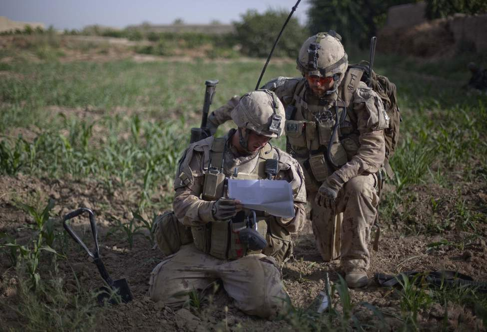 Sgt. Mathieu Pelletier, 33, right, and Master Cpl. Kevin Lomelin, 23, both of Quebec, Canada, with the Canadian Army's 1st Battalion Royal 22nd Regiment check their position on a map during their final operation Thursday, June 30, 2011 in the Panjwaii district of Kandahar province, Afghanistan. (AP Photo/David Goldman)