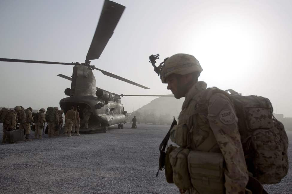 Cpl. Frederic Bouchard, 24, of Quebec, Canada, boards a helicopter at Forward Operating Base Sperwan Ghar with fellow soldiers of the Canadian Army's 1st Battalion Royal 22nd Regiment to begin their journey home Thursday, June 30, 2011 in the Panjwaii district of Kandahar province, Afghanistan. (AP Photo/David Goldman)